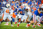 RB Mack Brown takes the handoff and finds an open hole up the middle.  Gators vs Tennessee Volunteers.  September 21, 2013.
