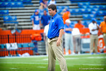 Gator head coach Will Muschamp watches his gator football team warm up for the Tennessee game.   Gators vs Tennessee Volunteers.  September 21, 2013.