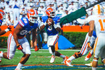 QB Tyler Murphy drops back to pas and looks downfield for an open Gator receiver.   Gators vs Tennessee Volunteers.  September 21, 2013.