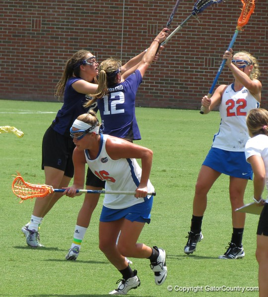 Nicole Graziano (16) and Brittany Dashiell (22) during the Florida Gators' 14-7 win against the Northwestern Wildcats in the ALC Championship on Saturday, May 5, 2012, at Donald R. Dizney Stadium in Gainesville, Fla. / Gator Country photo by MIke Capshaw