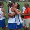 Players hug after the Gators' 14-7 win against Northwestern. Florida captured its first ALC Championship in the program's three-year history at Dizney Stadium in Gainesville, Fla., on Saturday. / Gator Country photo by Mike Capshaw