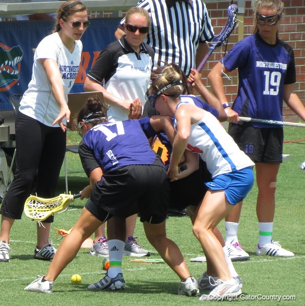 UF's Nora Barry battles a pair of Northwestern players for a ground ball during the Florida Gators' 14-7 win against the Northwestern Wildcats in the ALC Championship on Saturday, May 5, 2012, at Donald R. Dizney Stadium in Gainesville, Fla. / Gator Country photo by MIke Capshaw