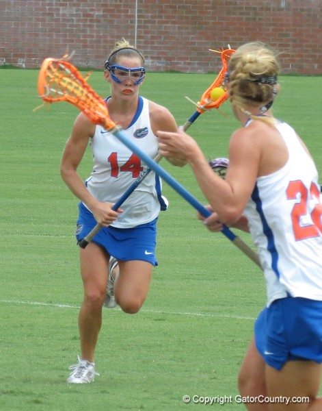 Nora Barry (14) and Brittany Dashiell (22) during the Florida Gators' 14-7 win against the Northwestern Wildcats in the ALC Championship on Saturday, May 5, 2012, at Donald R. Dizney Stadium in Gainesville, Fla. / Gator Country photo by MIke Capshaw