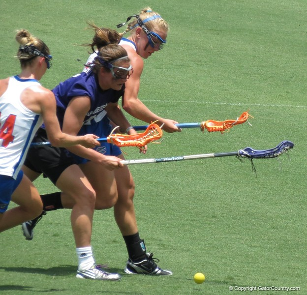 Nora Barry, left, and Brittany Dashiell vie for a ground ball during the Florida Gators' 14-7 win against the Northwestern Wildcats in the ALC Championship on Saturday, May 5, 2012, at Donald R. Dizney Stadium in Gainesville, Fla. / Gator Country photo by MIke Capshaw