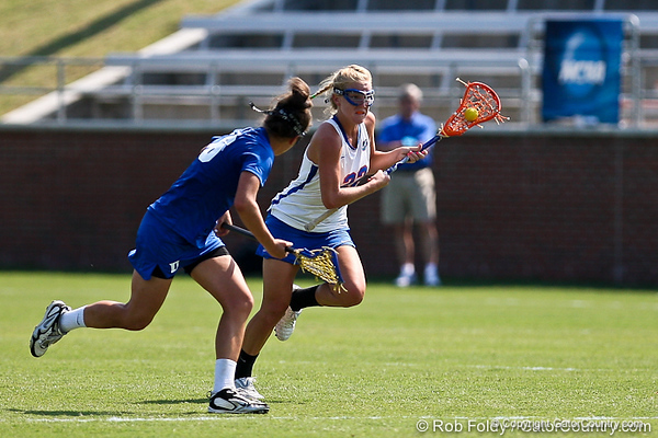 Florida sophomore midfielder Brittany Dashiell runs past a defender during the Gator's 9-13 loss against No. 5 Seed Duke in the NCAA Championship Quarterfinals on Saturday, May 21, 2011 at Donald R Dizney Lacrosse Stadium in Gainesville, Fla. / photo by Rob Foldy