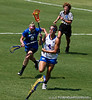 Florida sophomore Kitty Cullen passes a Duke defender during the Gator's 9-13 loss against No. 5 Seed Blue Devils in the NCAA Championship Quarterfinals on Saturday, May 21, 2011 at Donald R Dizney Lacrosse Stadium in Gainesville, Fla. / photo by Rob Foldy
