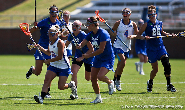 Florida sophomore midfielder Brittany Dashiell gets chased by a herd of Blue Devil players during the Gator's 9-13 loss against No. 5 Seed Duke in the NCAA Championship Quarterfinals on Saturday, May 21, 2011 at Donald R Dizney Lacrosse Stadium in Gainesville, Fla. / photo by Rob Foldy