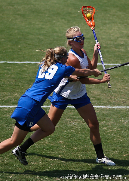 A Florida player wards off a defender during the Gator's 9-13 loss against No. 5 Seed Duke in the NCAA Championship Quarterfinals on Saturday, May 21, 2011 at Donald R Dizney Lacrosse Stadium in Gainesville, Fla. / photo by Rob Foldy