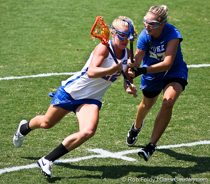 Florida sophomore midfielder Brittany Dashiell running past a defender during the Gator's 9-13 loss against No. 5 Seed Duke in the NCAA Championship Quarterfinals on Saturday, May 21, 2011 at Donald R Dizney Lacrosse Stadium in Gainesville, Fla. / photo by Rob Foldy