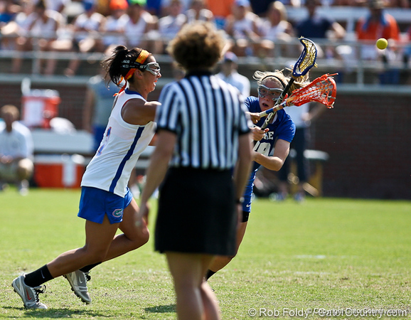 Florida sophomore midfielder Janine Hillier fires the ball during the Gator's 9-13 loss against No. 5 Seed Duke in the NCAA Championship Quarterfinals on Saturday, May 21, 2011 at Donald R Dizney Lacrosse Stadium in Gainesville, Fla. / photo by Rob Foldy