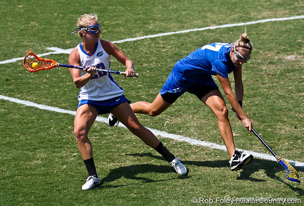 Florida sophomore midfielder Brittany Dashiell passes a defender during the Gator's 9-13 loss against No. 5 Seed Duke in the NCAA Championship Quarterfinals on Saturday, May 21, 2011 at Donald R Dizney Lacrosse Stadium in Gainesville, Fla. / photo by Rob Foldy