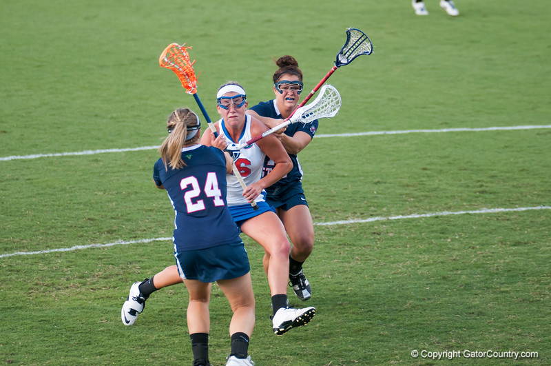 Florida freshman Nicole Graziano is pushed  during the Gators' 29-0 win against the Fresno State Bulldogs on Wednesday, March 28, 2012 at the Donald R. Dizney Stadium in Gainesville, Fla. / Gator Country photo by Saj Guevara