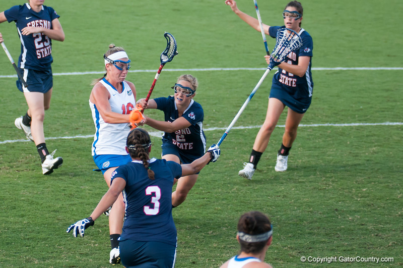 Florida freshman Nicole Graziano is challenged  during the Gators' 29-0 win against the Fresno State Bulldogs on Wednesday, March 28, 2012 at the Donald R. Dizney Stadium in Gainesville, Fla. / Gator Country photo by Saj Guevara