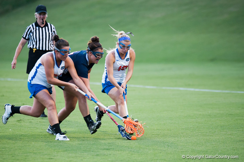 Florida junior Ashley Bruns  snd Taylor McCord fights for the ball during the Gators' 29-0 win against the Fresno State Bulldogs on Wednesday, March 28, 2012 at the Donald R. Dizney Stadium in Gainesville, Fla. / Gator Country photo by Saj Guevara