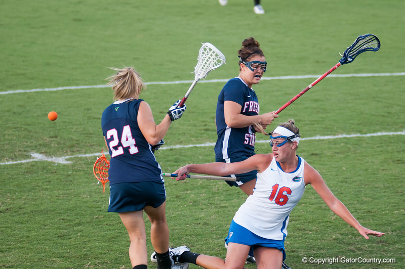 Florida freshman Nicole Graziano is pushed and falls during the Gators' 29-0 win against the Fresno State Bulldogs on Wednesday, March 28, 2012 at the Donald R. Dizney Stadium in Gainesville, Fla. / Gator Country photo by Saj Guevara