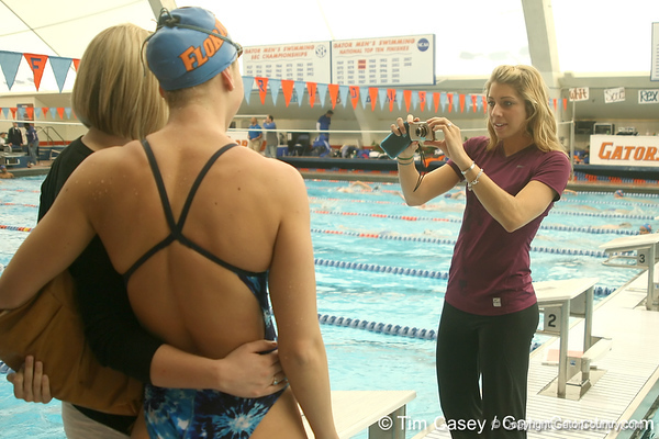 photo by Tim Casey<br /> <br /> Florida swimming alumna Caroline Burckle takes a photo after the Gators' final home swimming and diving meet of the season on Saturday, January 31, 2009 at the Stephen C. O'Connell Center in Gainesville, Fla.