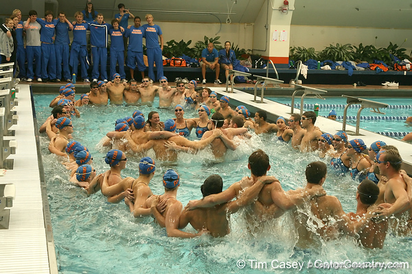 photo by Tim Casey<br /> <br /> The Florida swimming and diving team sings the UF alma mater after the Gators' final home meet of the season on Saturday, January 31, 2009 at the Stephen C. O'Connell Center in Gainesville, Fla.