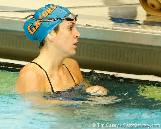 Florida senior Teresa Crippen finishes the women's 100-yard freestyle during the Gators' meet against the Florida Atlantic Owls on Saturday, January 14, 2012 at the Stephen C. O'Connell Center Natatorium in Gainesville, Fla. / Gator Country photo by Tim Casey