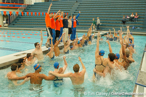 Florida swimmers and divers sing the UF alma matre after the Gators' meet against the Florida Atlantic Owls on Saturday, January 14, 2012 at the Stephen C. O'Connell Center Natatorium in Gainesville, Fla. / Gator Country photo by Tim Casey