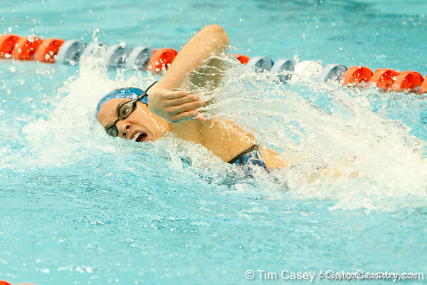 Florida senior Teresa Crippen competes in the women's 100-yard freestyle during the Gators' meet against the Florida Atlantic Owls on Saturday, January 14, 2012 at the Stephen C. O'Connell Center Natatorium in Gainesville, Fla. / Gator Country photo by Tim Casey