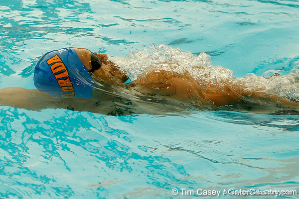 Florida freshman Christian-Paul Homer competes in the men's 100-yard backstroke during the Gators' meet against the Florida Atlantic Owls on Saturday, January 14, 2012 at the Stephen C. O'Connell Center Natatorium in Gainesville, Fla. / Gator Country photo by Tim Casey