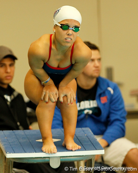 FAU swimmer Miranda Uhl competes in the women's 400-yard freestyle relay during the Owls' meet against the Florida Gators on Saturday, January 14, 2012 at the Stephen C. O'Connell Center Natatorium in Gainesville, Fla. / Gator Country photo by Tim Casey
