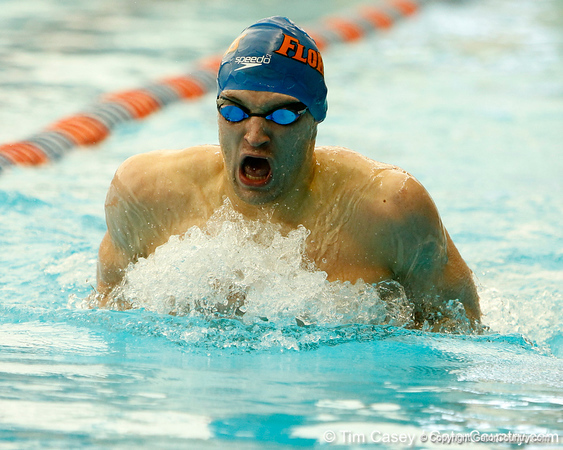 Florida freshman Ricky Munch competes in the men's 200-yard breaststroke during the Gators' meet against the Florida Atlantic Owls on Saturday, January 14, 2012 at the Stephen C. O'Connell Center Natatorium in Gainesville, Fla. / Gator Country photo by Tim Casey