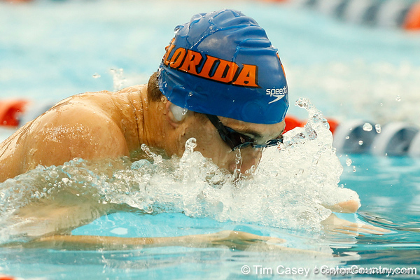 Florida senior Brian Howell competes in the men's 100-yard breaststroke during the Gators' meet against the Florida Atlantic Owls on Saturday, January 14, 2012 at the Stephen C. O'Connell Center Natatorium in Gainesville, Fla. / Gator Country photo by Tim Casey