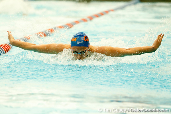 Florida senior Anna-Liisa Pold competes in the women's 100-yard butterfly during the Gators' meet against the Florida Atlantic Owls on Saturday, January 14, 2012 at the Stephen C. O'Connell Center Natatorium in Gainesville, Fla. / Gator Country photo by Tim Casey