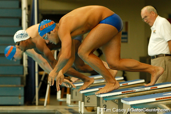 Florida freshman Carlos Omana competes in the men's 200-yard breaststroke during the Gators' meet against the Florida Atlantic Owls on Saturday, January 14, 2012 at the Stephen C. O'Connell Center Natatorium in Gainesville, Fla. / Gator Country photo by Tim Casey