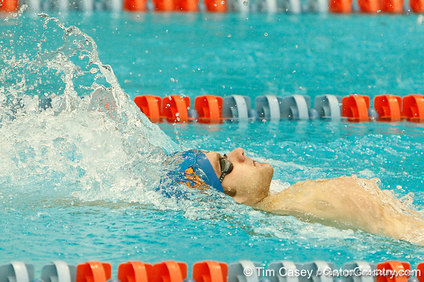 Florida freshman Austin Ringquist competes in the men's 200-yard backstroke during the Gators' meet against the Florida Atlantic Owls on Saturday, January 14, 2012 at the Stephen C. O'Connell Center Natatorium in Gainesville, Fla. / Gator Country photo by Tim Casey