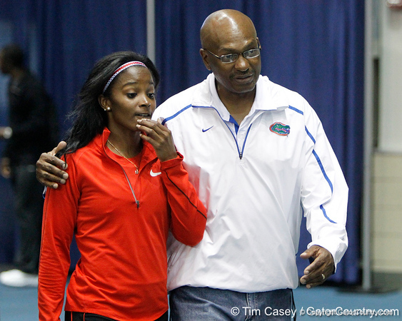 Florida head coach Mike Holloway talks with Kelli Wells (unattached) during the Gator Invite indoor track meet on Sunday, January 22, 2012 at the Stephen C. O'Connell Center in Gainesville, Fla. / Gator Country photo by Tim Casey