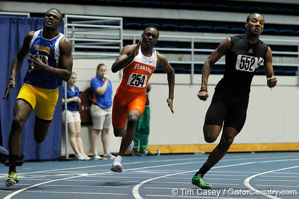 Florida freshman Michael Burris competes in the 200 meter dash during the Gator Invite indoor track meet on Sunday, January 22, 2012 at the Stephen C. O'Connell Center in Gainesville, Fla. / Gator Country photo by Tim Casey