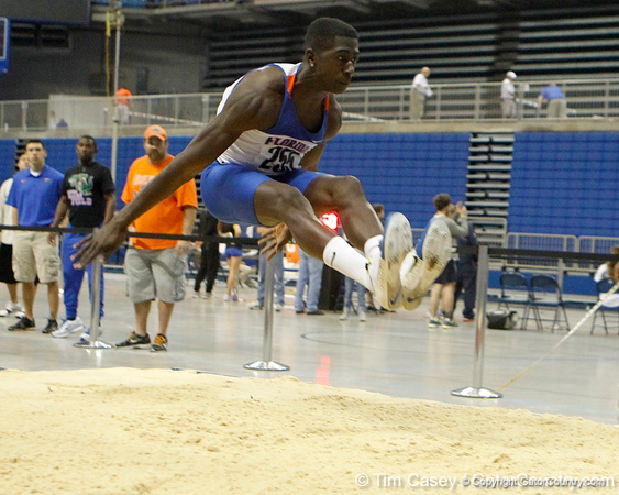 Florida freshman Marquis Dendy competes in the long jump during the Gator Invite indoor track meet on Sunday, January 22, 2012 at the Stephen C. O'Connell Center in Gainesville, Fla. / Gator Country photo by Tim Casey