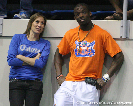 Florida coach Mellanee Welty and senior Frankie Hammond Jr. watches the high jump during the Gator Invite indoor track meet on Sunday, January 22, 2012 at the Stephen C. O'Connell Center in Gainesville, Fla. / Gator Country photo by Tim Casey
