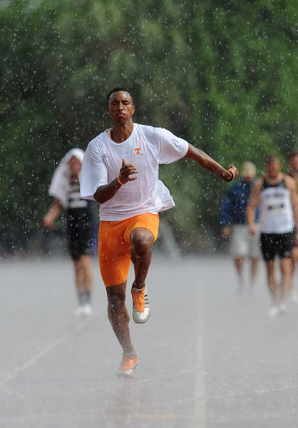 SEC Athletes move to cover as a severe weather warning is issued in Gainesville, Fla. on Thursday, May 14, 2009. The women's heptathlon and men's decathlon events  will be post-poned for sunnier weather. / Gator Country photo by Casey Brooke Lawson