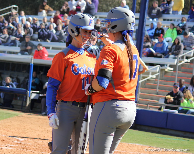 Ensley Gammel sharing a moment with Lauren Haeger after she scored during the Gators' 9-1 win against UNC Wilmington on Saturday, February 17, 2013, at Katie Seashole Pressly Stadium in Gainesville, Fla. / Gator Country photo by Danielle Bloch