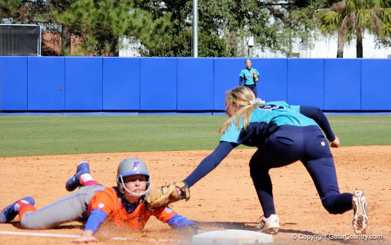 Freshman Taylore Fuller sliding to third base during the Gators' 9-1 win against UNC Wilmington on Saturday, February 17, 2013, at Katie Seashole Pressly Stadium in Gainesville, Fla. / Gator Country photo by Danielle Bloch