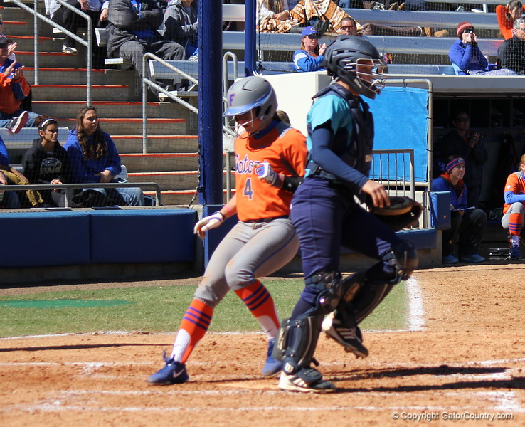 Sophomore Jessica Damico reaching home plate during the Gators' 9-1 win against UNC Wilmington on Saturday, February 17, 2013, at Katie Seashole Pressly Stadium in Gainesville, Fla. / Gator Country photo by Danielle Bloch