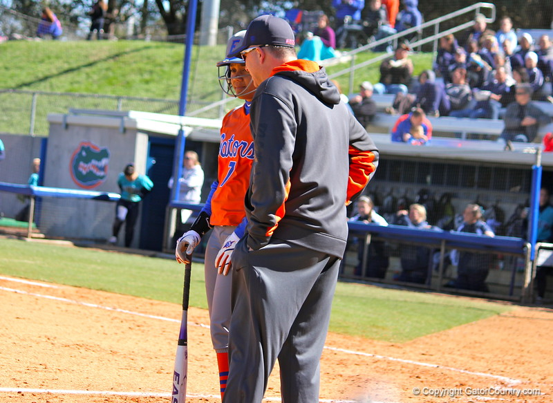 Freshman Kelsey Stewart talking with the coach during the Gators' 9-1 win against UNC Wilmington on Saturday, February 17, 2013, at Katie Seashole Pressly Stadium in Gainesville, Fla. / Gator Country photo by Danielle Bloch