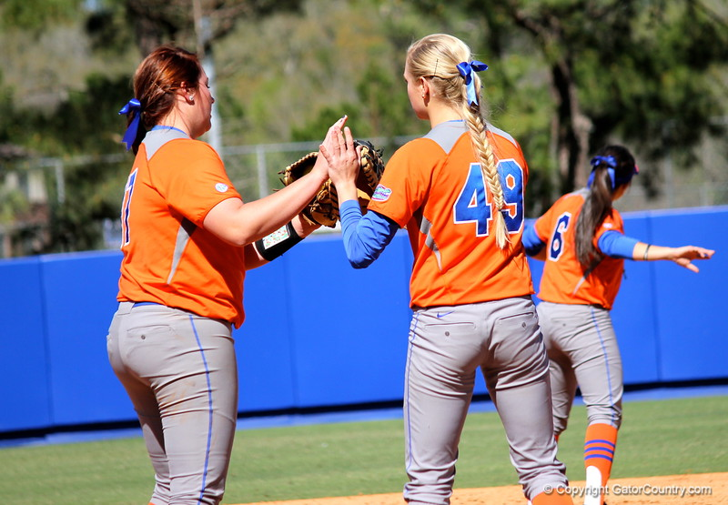 Lauren Haeger and Taylor Schwarz giving each other a high-five during the Gators' 9-1 win against UNC Wilmington on Saturday, February 17, 2013, at Katie Seashole Pressly Stadium in Gainesville, Fla. / Gator Country photo by Danielle Bloch