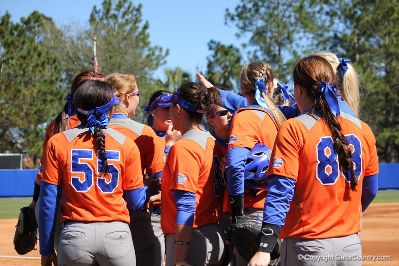 The team huddling in between innings during the Gators' 9-1 win against UNC Wilmington on Saturday, February 17, 2013, at Katie Seashole Pressly Stadium in Gainesville, Fla. / Gator Country photo by Danielle Bloch