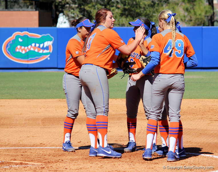 Teammates encouraging one another in between plays during the Gators' 9-1 win against UNC Wilmington on Saturday, February 17, 2013, at Katie Seashole Pressly Stadium in Gainesville, Fla. / Gator Country photo by Danielle Bloch