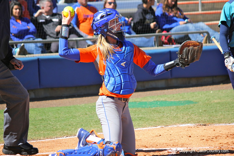 Catcher Aubree Munro throwing the ball back during the Gators' 9-1 win against UNC Wilmington on Saturday, February 17, 2013, at Katie Seashole Pressly Stadium in Gainesville, Fla. / Gator Country photo by Danielle Bloch