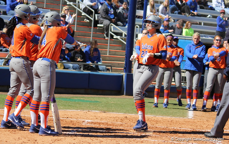 Senior Kelsey Horton getting gator chomped by her teammates after hitting a home run during the Gators' 9-1 win against UNC Wilmington on Saturday, February 17, 2013, at Katie Seashole Pressly Stadium in Gainesville, Fla. / Gator Country photo by Danielle Bloch