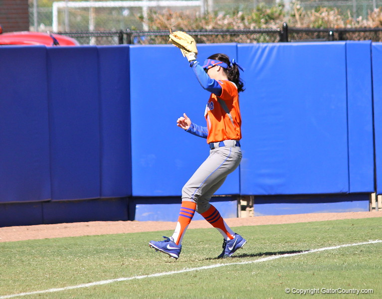Sophomore Kathlyn Medina catching a ball hit out of bounds during the Gators' 9-1 win against UNC Wilmington on Saturday, February 17, 2013, at Katie Seashole Pressly Stadium in Gainesville, Fla. / Gator Country photo by Danielle Bloch