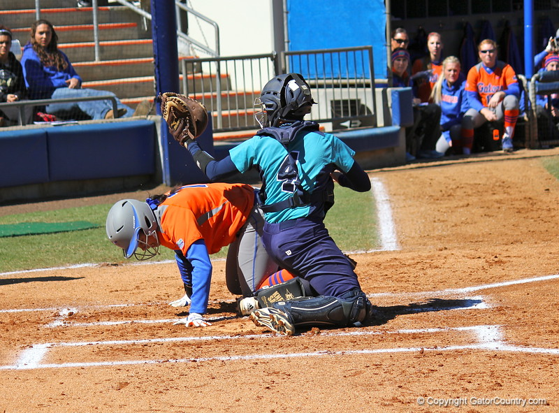 Freshman Kelsey Stewart after sliding home during the Gators' 9-1 win against UNC Wilmington on Saturday, February 17, 2013, at Katie Seashole Pressly Stadium in Gainesville, Fla. / Gator Country photo by Danielle Bloch