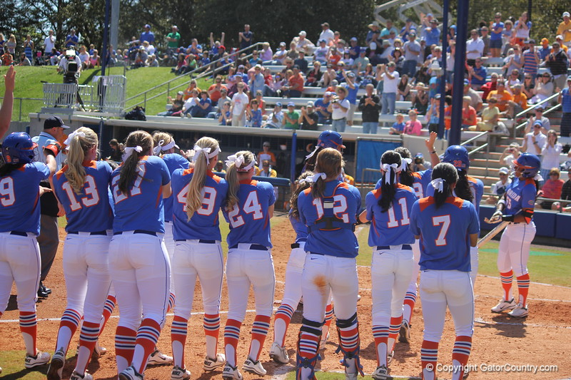 The team meeting Lauren Haeger at home plate after her home run during the Gator's softball game against University of Tennessee on Saturday March 16, 2013, at Katie Seashole Pressly Stadium in Gainesville, Fla. / Gator Country photo by Danielle Bloch