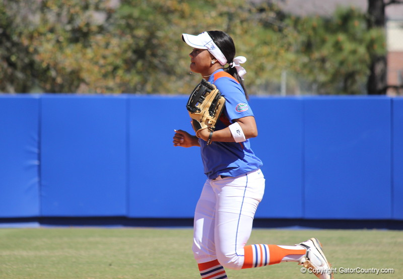 Freshman Kelsey Stewart running back to the dugout at the end of an inning during the Gator's softball game against University of Tennessee on Saturday March 16, 2013, at Katie Seashole Pressly Stadium in Gainesville, Fla. / Gator Country photo by Danielle Bloch