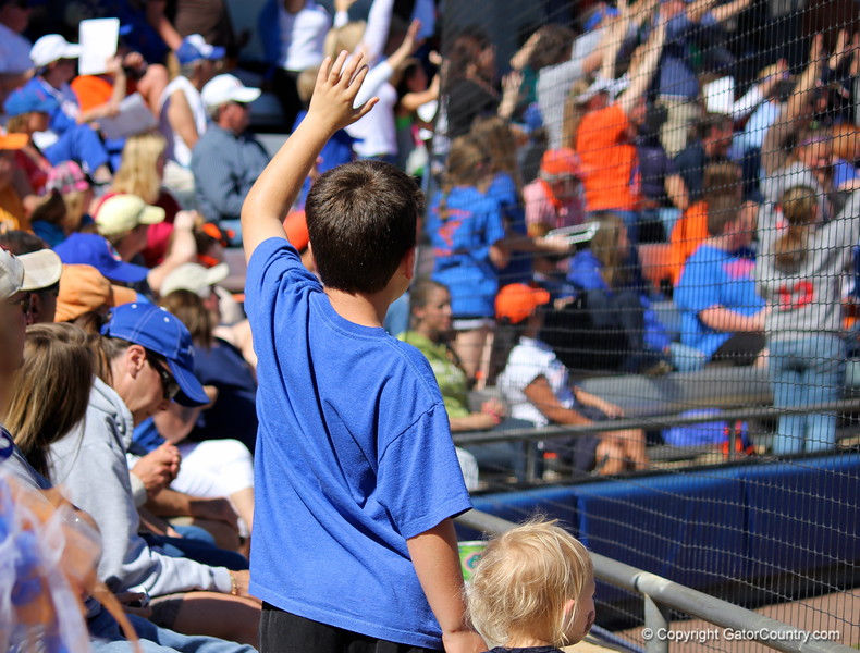 A fan rising to try to win a strike out t-shirt during the Gator's softball game against University of Tennessee on Saturday March 16, 2013, at Katie Seashole Pressly Stadium in Gainesville, Fla. / Gator Country photo by Danielle Bloch